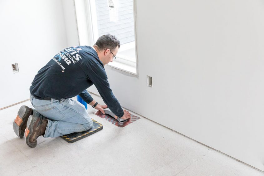technician covering ac duct