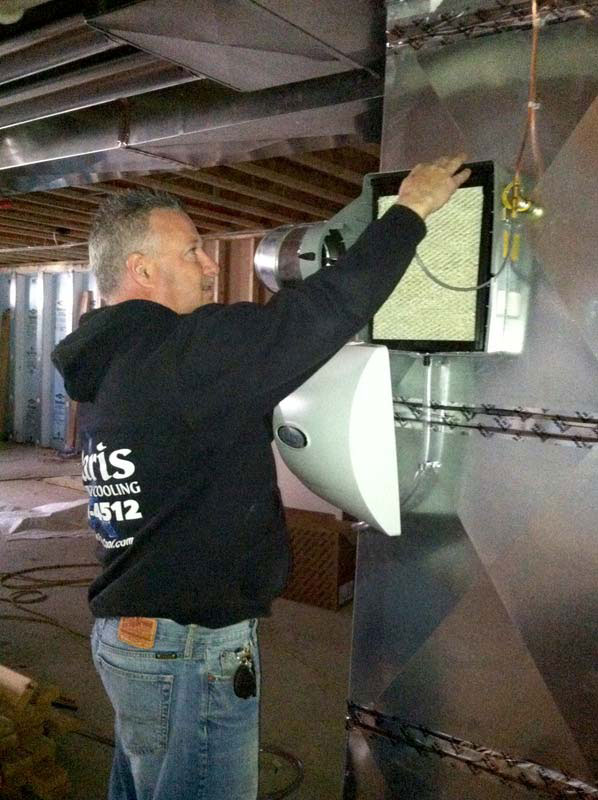 man installing home humidifier system