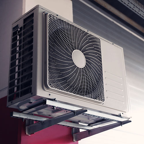 air conditioner attached to wall